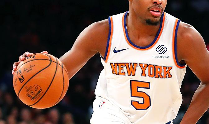 NBA-speler met basketbal